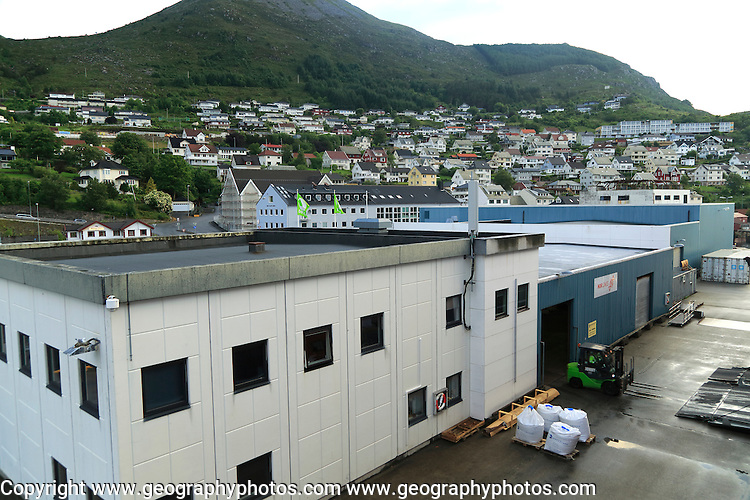 Port buildings and traditional houses in coastal town of Kristiansund, Romsdal county, Norway