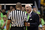 03 December 2014: UNC head coach Roy Williams (right) talks to referee Michael Roberts (left). The University of North Carolina Tar Heels played the University of Iowa Hawkeyes in an NCAA Division I Men's basketball game at the Dean E. Smith Center in Chapel Hill, North Carolina. Iowa won the game 60-55.