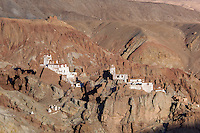 Basgo, once the capital of lower Ladakh, lies in ruins today, 60 km from Leh. It was once a seat of power of a branch of the Namgyal family and an important cultural and political centre and is frequently mentioned in the Ladakhi Chronicles. The monastery is situated on top of the hill towering over the ruins of the ancient town and it noted for its Buddha statue and murals. An early palace in Basgo was built in the 15th century.