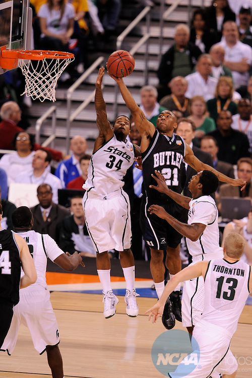 3 APR 2010:  Korie Lucious (34) of Michigan State University drives downcourt against Willie Veasley (21) of Butler University during the NCAA Division I Men's Basketball Semifinal game held at the Lucas Oil Stadium in Indianapolis, IN. Butler University went on to defeat Michigan State University 52-50 to advance to the championship game. Brett Wilhelm/NCAA Photos