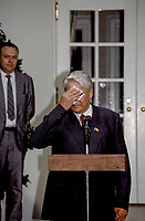 Washington, DC., USA, June 20, 1991<br /> Russian President Boris Yletsin wipes off some sweat from his forehead while delivering  remarks in the Rose Garden of the White House after his meeting in the Oval Office with President George H.W. Bush. Credit: Mark Reinstein/MediaPunch