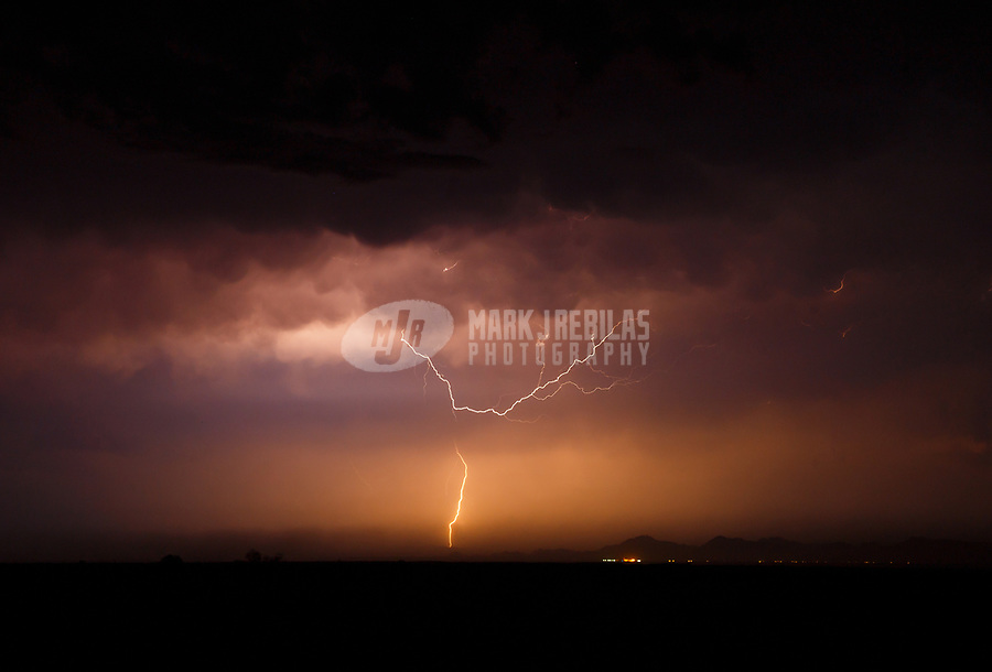 Sep 7, 2017; Yuma, Arizona, USA;   Lightning strikes over the desert during a summer monsoon thunderstorm and dust storm. Mandatory Credit: Mark J. Rebilas