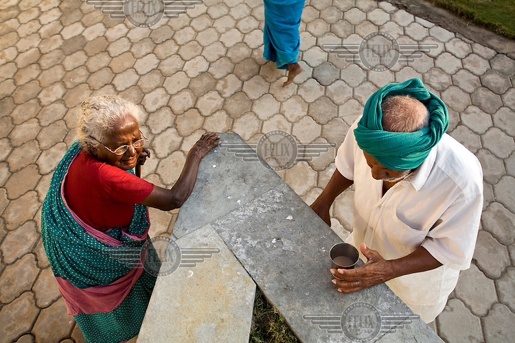 Uthiradam and Vairakannu take a break for tea after their exercise session at the Tamaraikulum Elders's Village. The village is a pioneering experiment initially set up by HelpAge India after the Asian Tsunami to help elderly people displaced by the natural disaster. Today, the village is a self-sustaining community providing a family environment where more able-bodied residents assist the less able-bodied and provides 100 older people with a safe place to live, free healthcare, emotional security, a good diet and professional care and support...
