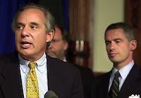 U.S. Senator Robert Torricell (L), announces he is dropping out of the US Senate race, as New Jersey Governor James McGreevey (R) listens, Monday, Sept. 30, 2002, in Trenton, New Jersey. Directly behind Torricelli is U.S. Senator Jon Corzine. (Photo by William Thomas Cain/photodx.com)