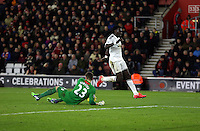 Pictured: Bafetimbi Gomis of Swansea (R) fails to catch a cross, Southampton goalkeeper Fraser Forster (L) catches the ball Sunday 01 February 2015<br /> Re: Premier League Southampton v Swansea City FC at ST Mary's Ground, Southampton, UK.