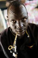 South Sudan, Cuibet, Dinka man smoking tobacco pipe / SUEDSUDAN Cuibet , Dinka Mann raucht Tabakpfeife