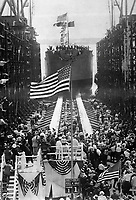 Launching the Quistconck, first completed at Hog Island shipyards.  The President and Mrs. Wilson are standing on the platform on opposite sides of the flagpole.  Mrs Wilson christened the vessel.  Ca.  1918.  Carl Thoner.   (War Dept.)<br /> Exact Date Shot Unknown<br /> NARA FILE #:  165-WW-492A-9<br /> WAR & CONFLICT BOOK #:  541