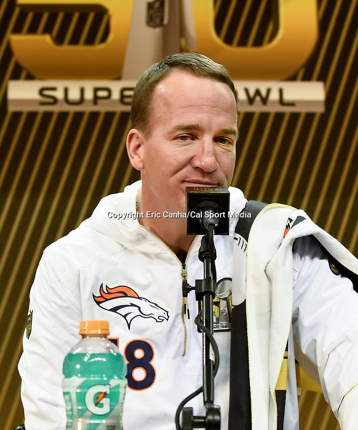Monday, February 1, 2016: Denver Broncos quarterback Peyton Manning (18) talks to members of the media during the opening day of press conferences for the National Football League Super Bowl 50 between the Denver Broncos and the Carolina Panthers at the SAP Center, in San Jose, California. Eric Canha/CSM
