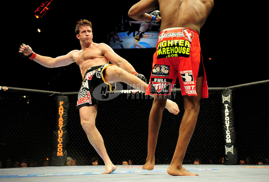 Jan. 31, 2009; Las Vegas, NV, USA; UFC fighter Stephan Bonnar (black trunks) kicks Jon Jones (red trunks) during the light heavyweight swing bout in UFC 94 at the MGM Grand Hotel and Casino. Mandatory Credit: Mark J. Rebilas-