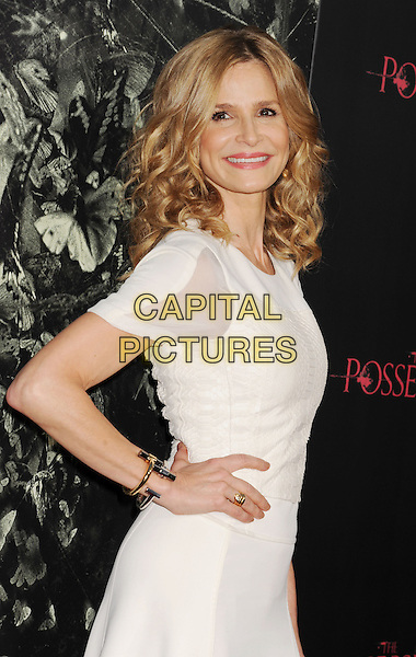 "Kyra Sedgwick.""The Possession"" Los Angeles Premiere held at Arclight Cinemas, Hollywood, California, USA..August 28th, 2012.half length dress white sheer hand on hip side .CAP/ROT/TM.©Tony Michaels/Roth Stock/Capital Pictures"