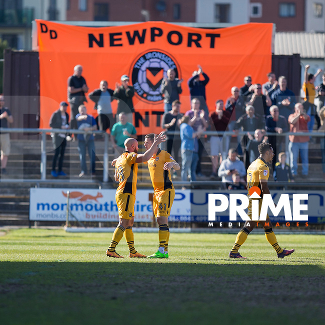 David Pipe and Aaron Williams of Newport County celebrate their side's win at full time of the Sky Bet League 2 match between Newport County and Accrington Stanley at Rodney Parade, Newport, Wales on 22 April 2017. Photo by Mark  Hawkins.