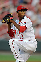 Relief pitcher Sergio Gomez (13) of the Greenville Drive delivers a pitch in a game against the Augusta GreenJackets on Thursday, July 10, 2014, at Fluor Field at the West End in Greenville, South Carolina. Augusta won, 8-2. (Tom Priddy/Four Seam Images)