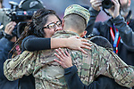 A surprise homecoming for a Army soldier's family during the Armed Forces Bowl game between the San Diego State Aztecs and the Army Black Knights at the Amon G. Carter Stadium in Fort Worth, Texas.