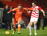 Blackpool's Ryan McLaughlin and Doncaster Rovers' John Marquis<br /> <br /> Photographer Rachel Holborn/CameraSport<br /> <br /> The EFL Sky Bet League One - Doncaster Rovers v Blackpool - Tuesday 27th November 2018 - Keepmoat Stadium - Doncaster<br /> <br /> World Copyright &copy; 2018 CameraSport. All rights reserved. 43 Linden Ave. Countesthorpe. Leicester. England. LE8 5PG - Tel: +44 (0) 116 277 4147 - admin@camerasport.com - www.camerasport.com