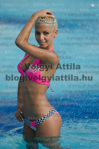 Szilvia Kalman poses for photographers after winning the Miss Bikini Hungary beauty contest held in Budapest, Hungary on August 06, 2011. ATTILA VOLGYI