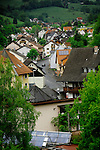 Mespelbrunn village showing roofs of homes and surrounding countryside. With solar panels on house in the foreground. Mespelbrunn close to Aschaffenburg, Elsava valley. Germany