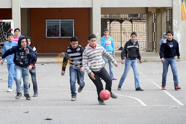 Palestinian children play the foot ball in street at regions Nahr al-Bared Palestinian refugee camp in Beirut, in Lebanon, March 6, 2012. About 25,000 person live in this poor refugee camp who face hard and difficult life. Photo by Mohammed Asad