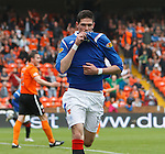Kyle Lafferty celebrates his goal by kissing the Rangers crest on his shirt