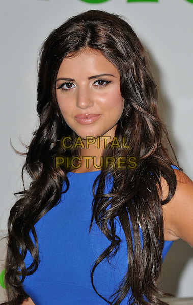 Lucy Mecklenburgh launches QuidCo Cashback Boutique, Oxford Street, London..28th June 2012 .headshot portrait blue sleeveless .CAP/WIZ.© Wizard/Capital Pictures.