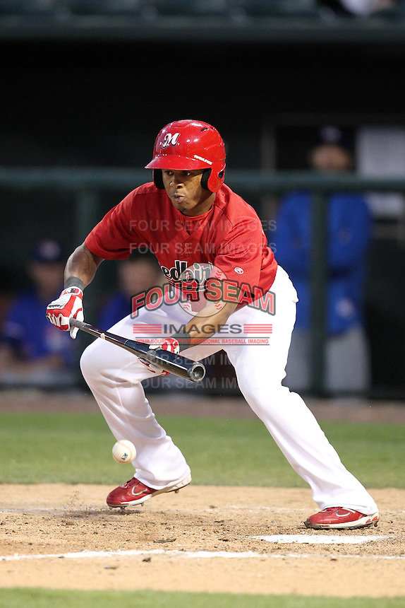 Memphis Redbirds outfielder Adron Chambers #4 at bat during a game versus the Round Rock Express at Autozone Park on April 29, 2011 in Memphis, Tennessee.  Round Rock defeated Memphis by the score of 5-4 in 13 innings.  Photo By Mike Janes/Four Seam Images