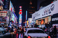 Cars drive under snow through Times Square in New York  01/17/2016 Photo by VIEWpress