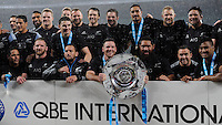 New Zealand celebrate with the Hillary Shield after winning the QBE International match between England and New Zealand at Twickenham Stadium on Saturday 8th November 2014 (Photo by Rob Munro)