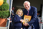 Lucy Bolger presents the President of Glen Dimplex, Martin Naughton, with a book at the official opening of the new school extension at Scoil Bhride Dunleer. Photo:  Andy Spearman.