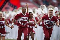 NWA Democrat-Gazette/CHARLIE KAIJO Arkansas Razorbacks cheerleaders run out onto the field during a football game on Saturday, November 4, 2017 at Razorback Stadium in Fayetteville
