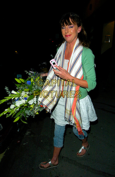 """DOON MACKICHAN.Leaving the """"Boeing Boeing"""" evening performance, Comedy Theatre, London, England. .August 30th, 2007.full length jeans denim flip flops cropped striped stripes scarf green top mobile phone flowers bouquet .CAP/CAN.©Can Nguyen/Capital Pictures"""