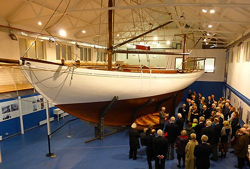The Larry Archer-built replica of the Asgard dinghy nestles under the ship herself in Collins Barracks