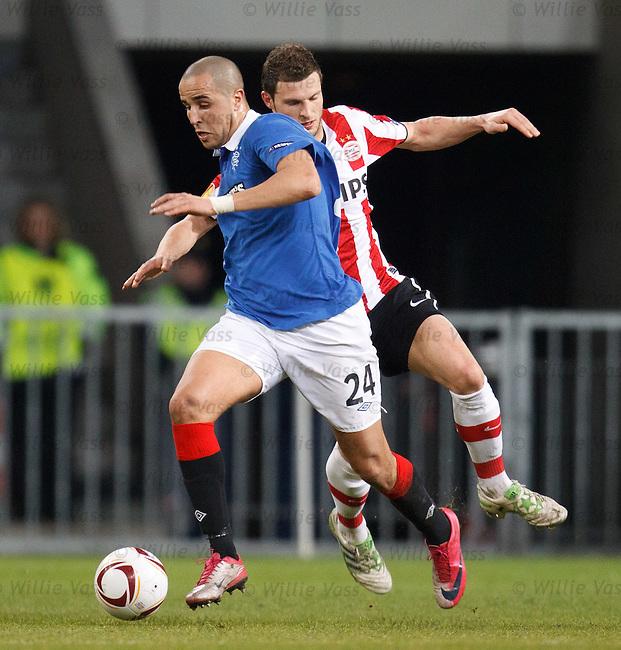 Madjid Bougherra uses his bulk to ease past Erik Pieters