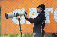 Daily News photographer Grant Matthew shoots the the international women's hockey match between the New Zealand Black Sticks and Malaysia at TET Stadium, Stratford, New Zealand on Thursday, 15 December 2016. Photo: Dave Lintott / lintottphoto.co.nz