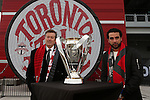 08 December 2016: Toronto mayor John Tory (left) and Canadian soccer legend Dwayne De Rosario (right) pose with the trophy. Major League Soccer's Philip F. Anschutz Trophy made an appearance with Toronto's mayor at a press conference outside of BMO Field in Toronto, Ontario in Canada two days before MLS Cup 2016.