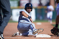 Surprise Saguaros right fielder LaMonte Wade (15), of the Minnesota Twins organization, slides into third base during an Arizona Fall League game against the Scottsdale Scorpions on October 27, 2017 at Scottsdale Stadium in Scottsdale, Arizona. The Scorpions defeated the Saguaros 6-5. (Zachary Lucy/Four Seam Images)