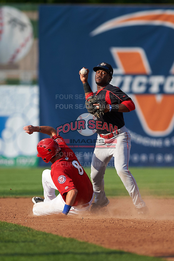 Batavia Muckdogs shortstop Anfernee Seymour (3) throws to first as Ian Sagdal (8) slides into second during a game against the Auburn Doubledays on September 7, 2015 at Falcon Park in Auburn, New York.  Auburn defeated Batavia 11-10 in ten innings.  (Mike Janes/Four Seam Images)