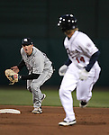 Sky Sox DJ LeMahieu runs down Reno Aces Evan Frey in a pickle during a triple-A minor league baseball game between the Reno Aces and the Colorado Springs Sky Sox on Thursday, April 5, 2012, in Reno, Nev. The Aces won the season-opener 5-2..Photo by Cathleen Allison