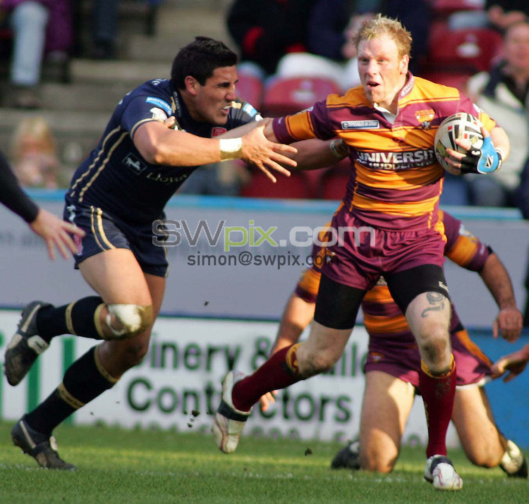 PICTURE BY WILL JOHNSTON/SWPIX.COM - Rugby League - Super League - Huddersfield Giants v Hull KR - Galpharm Stadium, Huddersfield, England - 18/02/07...Copyright - Simon Wilkinson - 07811 267706...Huddersfield's Paul Reilly pushes away Hull's David Tangata Toa