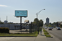 """4/5/16 Jackson,MS. In response to the Mississippi Religious Freedom bill being signed into law by Governor Phil Bryant Planting Peace a nonprofit rented a billboard in the shadow of the State Capital and makes fun of the law it depicts a image of Jesus and  It says """"  Guys , I said I hate Figs..and to Love Thy neighbor."""" The billboard and Planting Peace hope to remind Christians of the """"Golden Rule."""" Photo ©Suzi Altman"""