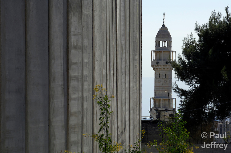 A mosque in Bethlehem is dwarfed by the Israeli separation barrier which has sealed off the Palestinian city from nearby Jerusalem..