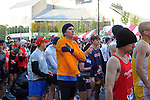 Denis Brogniart, French host of French reality television show Survivor, warms up in the first corral on Columbus Drive just before the start of the Chicago Marathon in Chicago, Illinois on October 11, 2009.