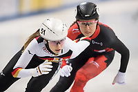 1st February 2019, Dresden, Saxony, Germany; World Short Track Speed Skating; 1000 meters women in the EnergieVerbund Arena. Anna Seidel (l) from Germany on the track ahead of Claudia Gagnon from Canada.
