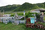 Orchid Island (蘭嶼), Taiwan -- The recently built 'trash museum' with compacted trash outside.