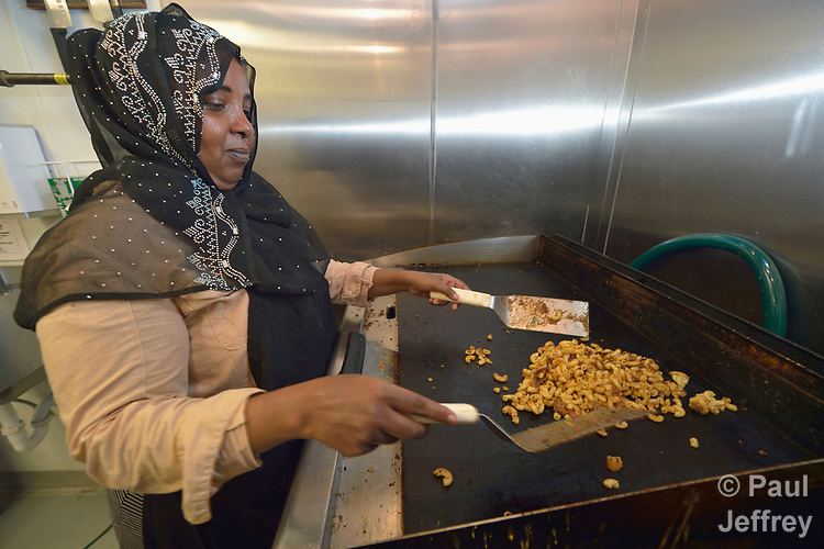 Sabah Mohamed, a refugee from Somalia, works in a restaurant in Durham, North Carolina, where she was resettled with assistance from Church World Service.<br /> <br /> <br /> Photo by Paul Jeffrey for Church World Service.