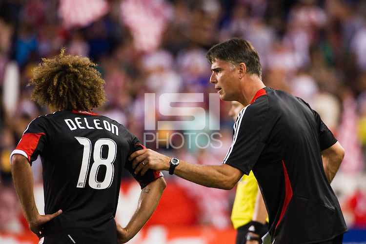 DC United assistant coach Pat Onstad  talks with Nick DeLeon (18). The New York Red Bulls defeated DC United 3-2 during a Major League Soccer (MLS) match at Red Bull Arena in Harrison, NJ, on June 24, 2012.
