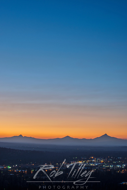 USA, OR, Bend, Twilight View of Bend and Cascade Mountains From Pilot Butte