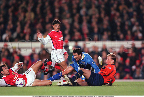 GILLES GRIMANDI fouls Gustavo Poyet, giving Chelsea their first half penalty. ARSENAL 0 v Chelsea 5, Highbury, 981111. Photo:Neil Tingle/Action Plus...1998.Soccer.Aggression.Slide-tackle .football.foul fouls fouling fouled.premiership premier league.club clubs.tackle tackles tackling tackled