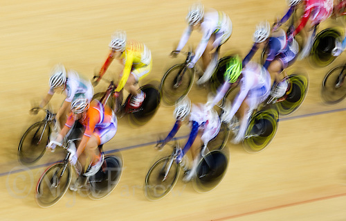 19 FEB 2012 - LONDON, GBR - Competitors race round the track during the Women's Omnium Scratch Race at the UCI Track Cycling World Cup, and London Prepares test event for the 2012 Olympic Games, in the Olympic Park Velodrome in Stratford, London, Great Britain (PHOTO (C) 2012 NIGEL FARROW)