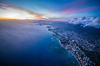 A high-elevation view at dusk of Waikiki, downtown Honolulu and beyond, O'ahu.