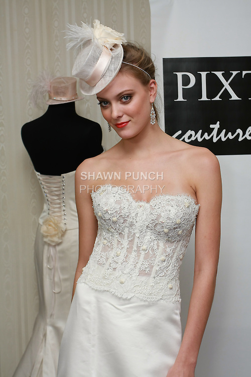 Model poses in a Capulet wedding dress by Kimberly Pixton Millar, for the Pixton Couture Bridal Spring 2011 presentation during the WeddingChannel Couture Show, October 18, 2010.