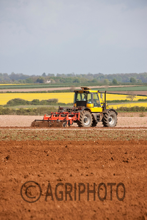 JCB Fast Trac working land down ready for planting potatoes